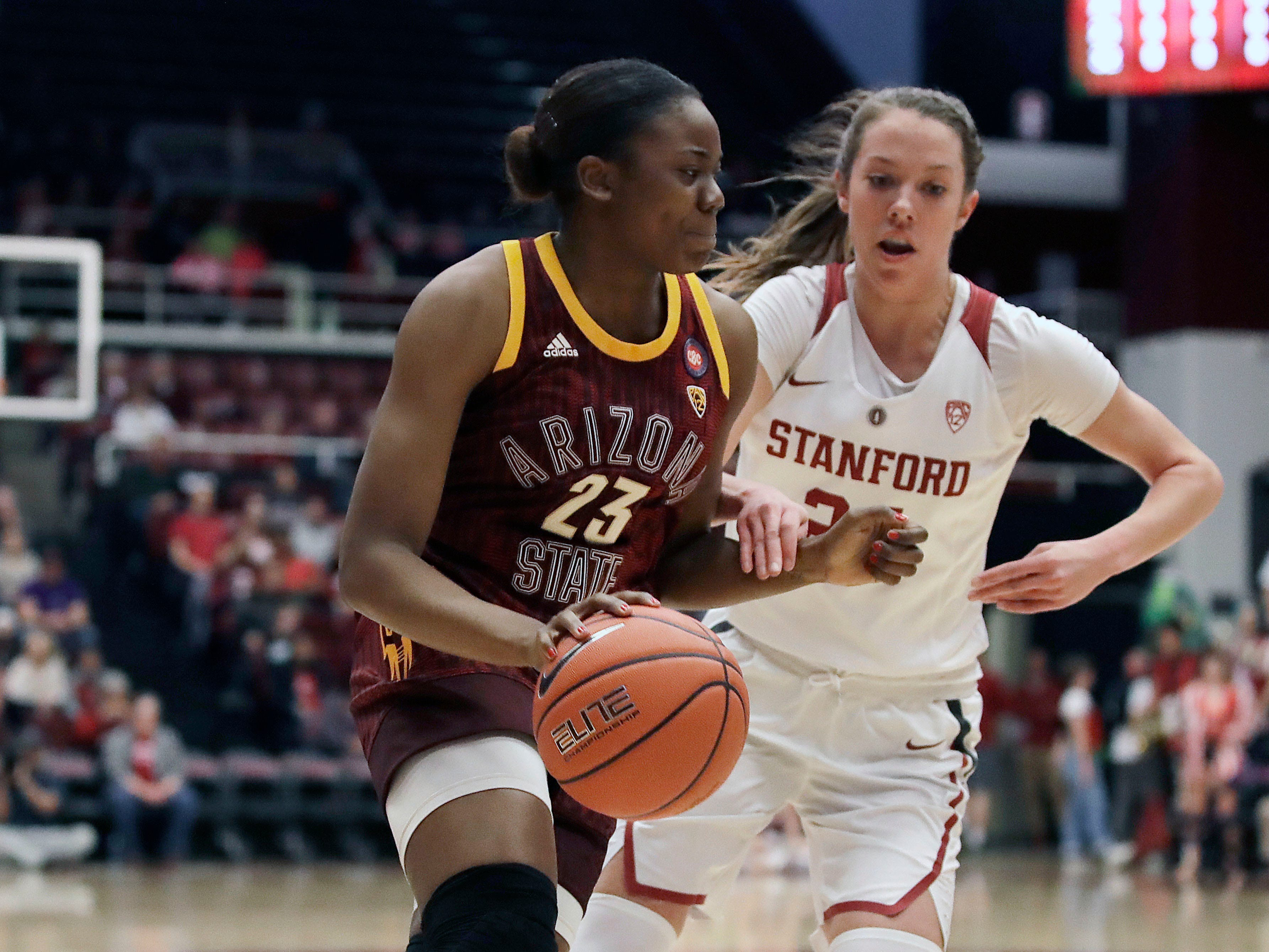 Arizona State's Iris Mbulito, left, drives the ball against Stanford's Lacie Hull during the first half of an NCAA college basketball game Sunday, Feb. 24, 2019, in Stanford, Calif.