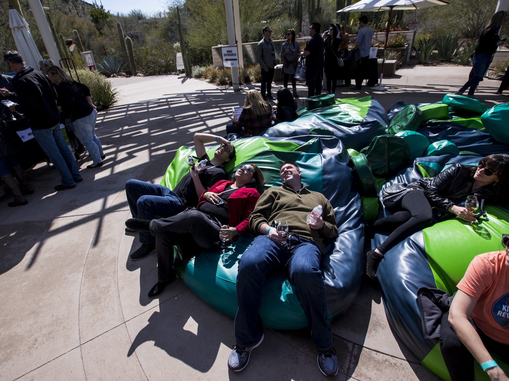 People relax on cushions during Day 1 of the Devour Culinary Classic on Saturday, Feb. 23, 2019, at Desert Botanical Garden in Phoenix.
