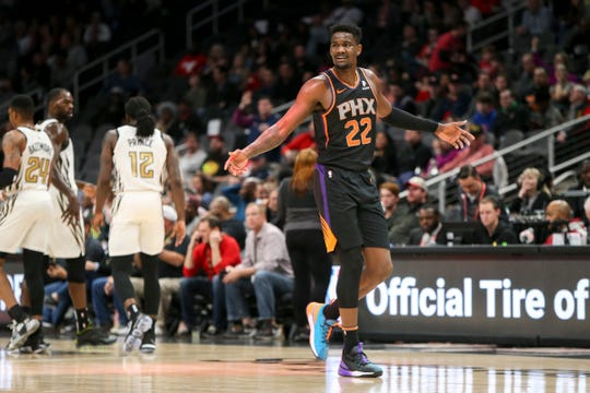 Feb 23, 2019: Phoenix Suns center Deandre Ayton (22) shows emotion against the Atlanta Hawks in the first quarter at State Farm Arena.