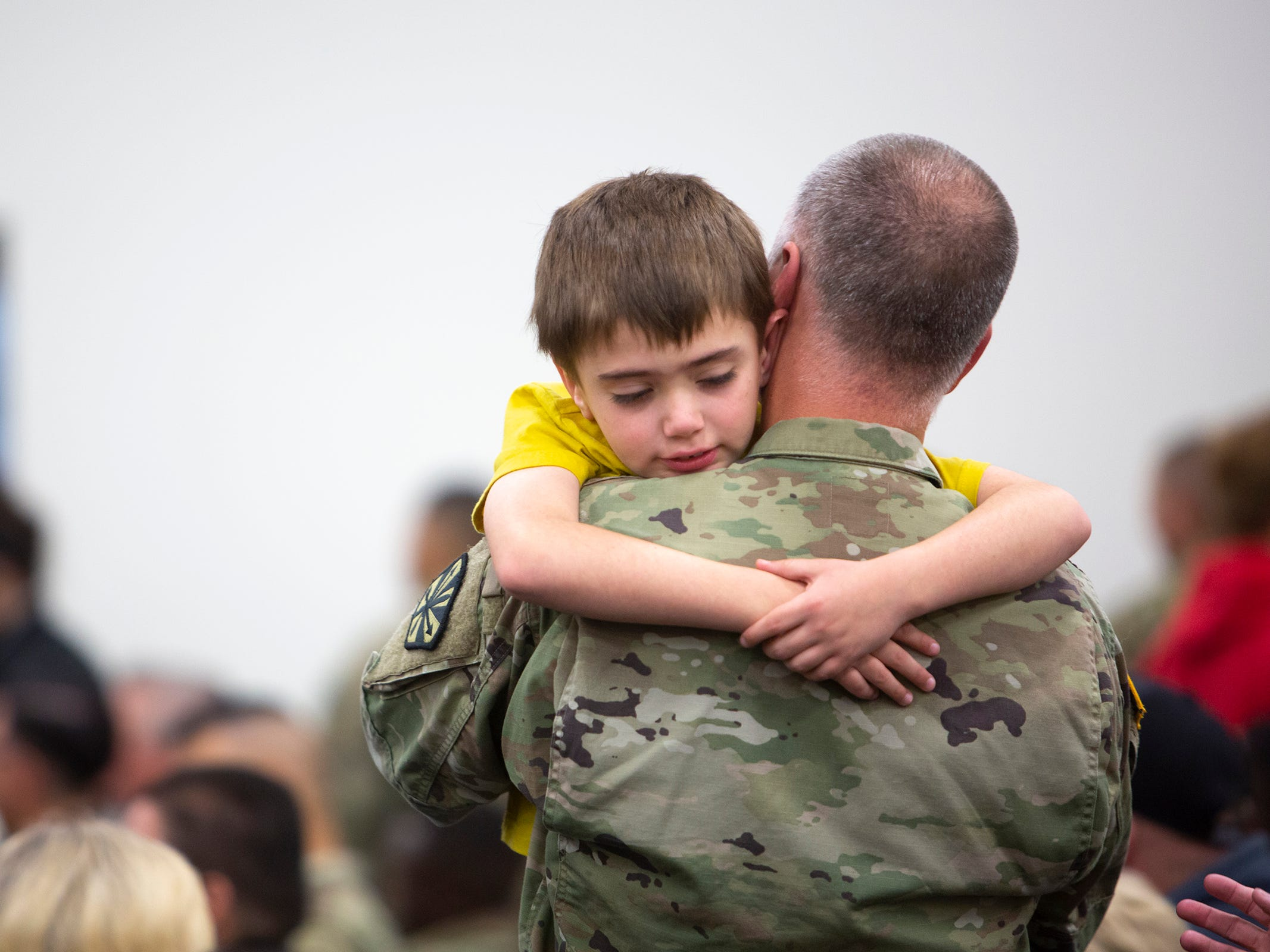 Skeet Bowman, 8, gives his father Staff Sgt. Jason Bowman a hug before the deployment ceremony for the 253rd Engineer Battalion at Papago Park Military Reservation on Sunday, Feb. 24, 2019. The soldiers boarded buses immediately after the ceremony.