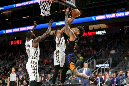 Feb 23, 2019: Phoenix Suns forward Kelly Oubre Jr. (3) is defended by Atlanta Hawks guard Kent Bazemore (24) in the first quarter at State Farm Arena.