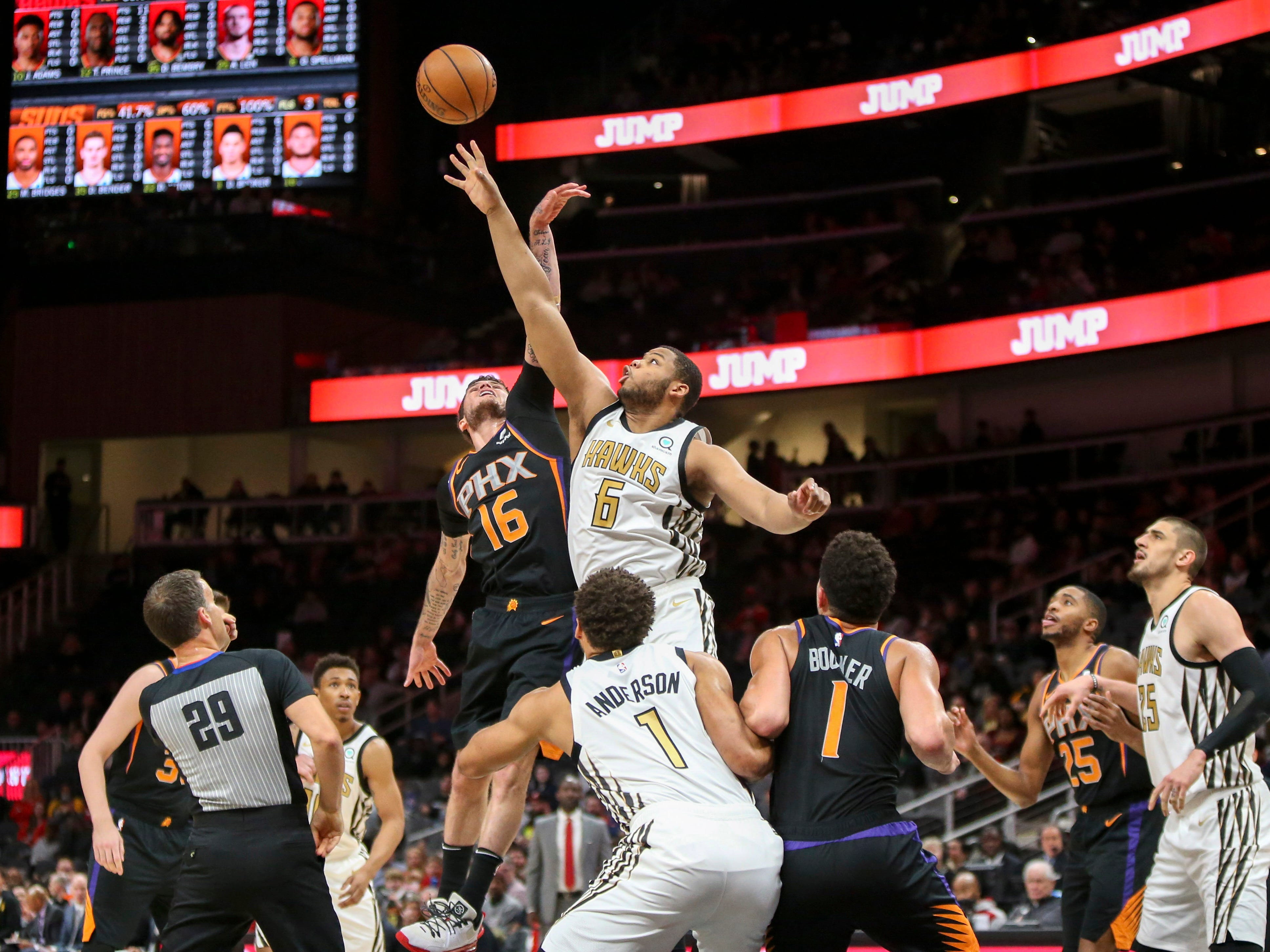 Feb 23, 2019: Atlanta Hawks forward Omari Spellman (6) tips a jump ball over Phoenix Suns guard Tyler Johnson (16) in the first quarter at State Farm Arena.