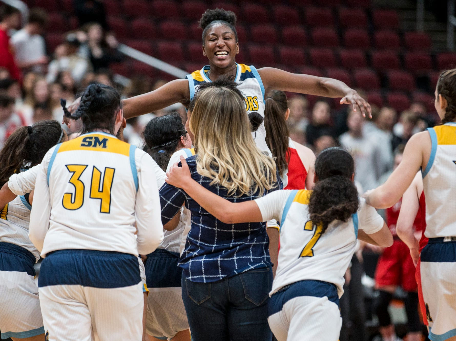 Shadow Mountain's celebrates after defeating Seton Catholic for the 4A girls basketball championship on Saturday, Feb. 23, 2019, at Gila River Arena in Glendale, Ariz.