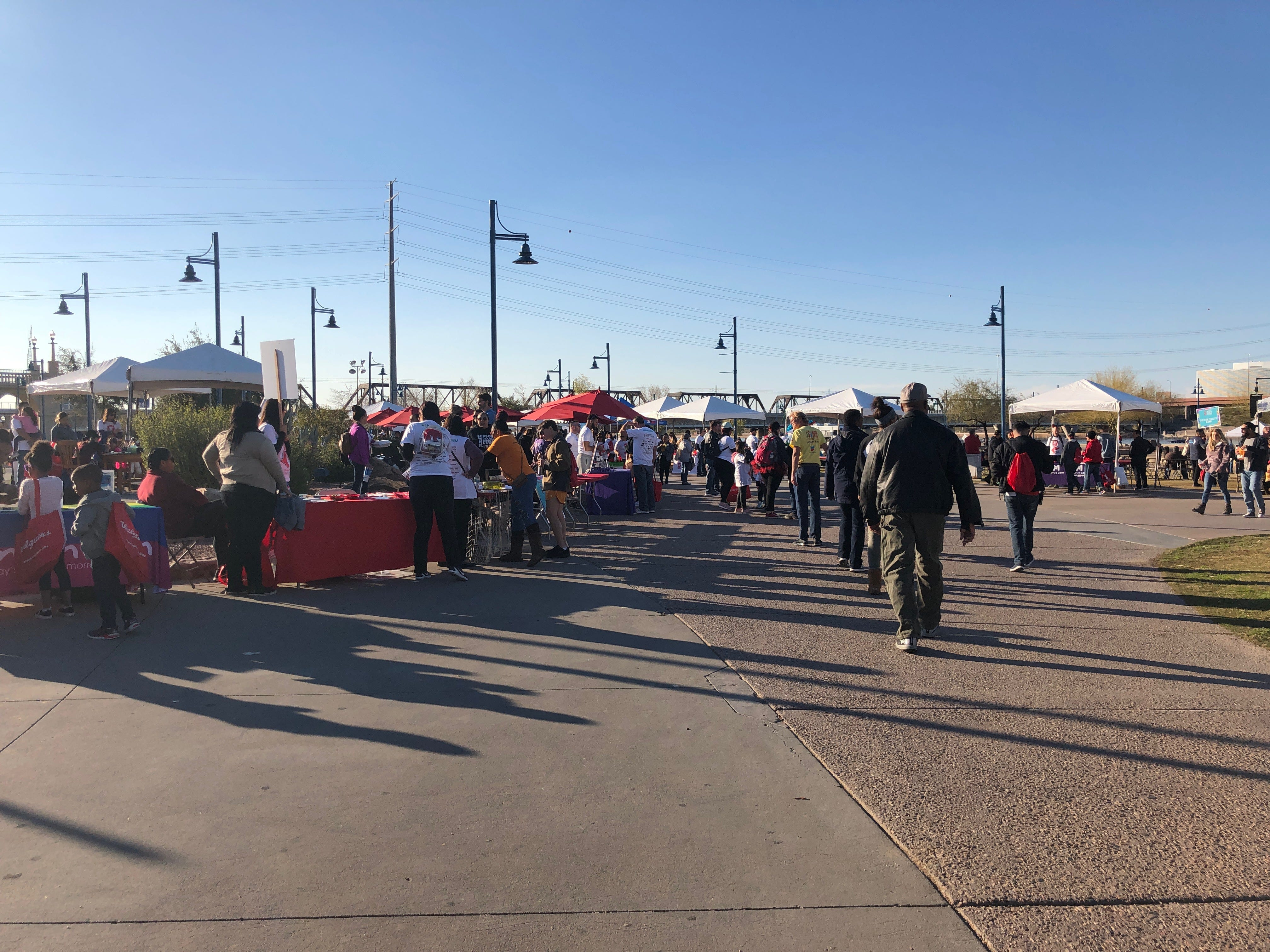 People walk around the vendors at the AIDS Walk Arizona at Tempe Beach Park.