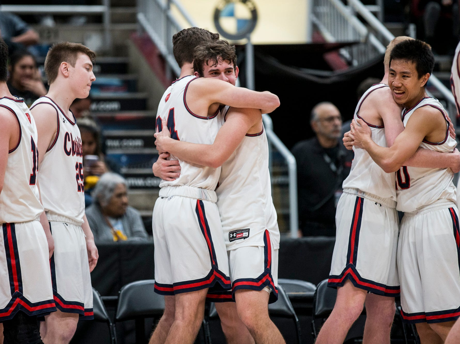 Scottsdale Christian celebrates before defeating Alchesay for the 2A boys basketball championship on Saturday, Feb. 23, 2019, at Gila River Arena in Glendale, Ariz.