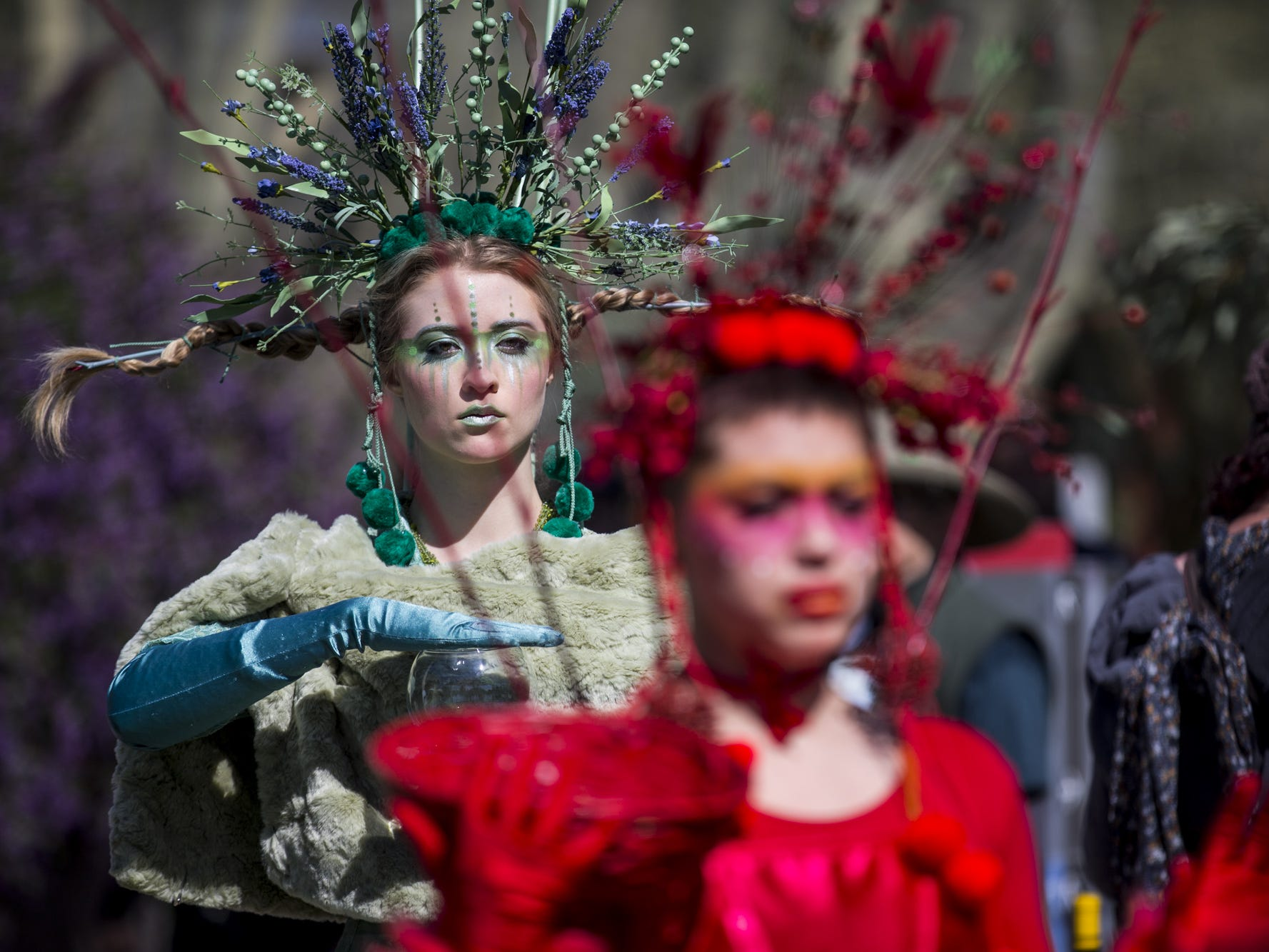 Performance artists walk during Day 1 of the Devour Culinary Classic on Saturday, Feb. 23, 2019, at Desert Botanical Garden in Phoenix.