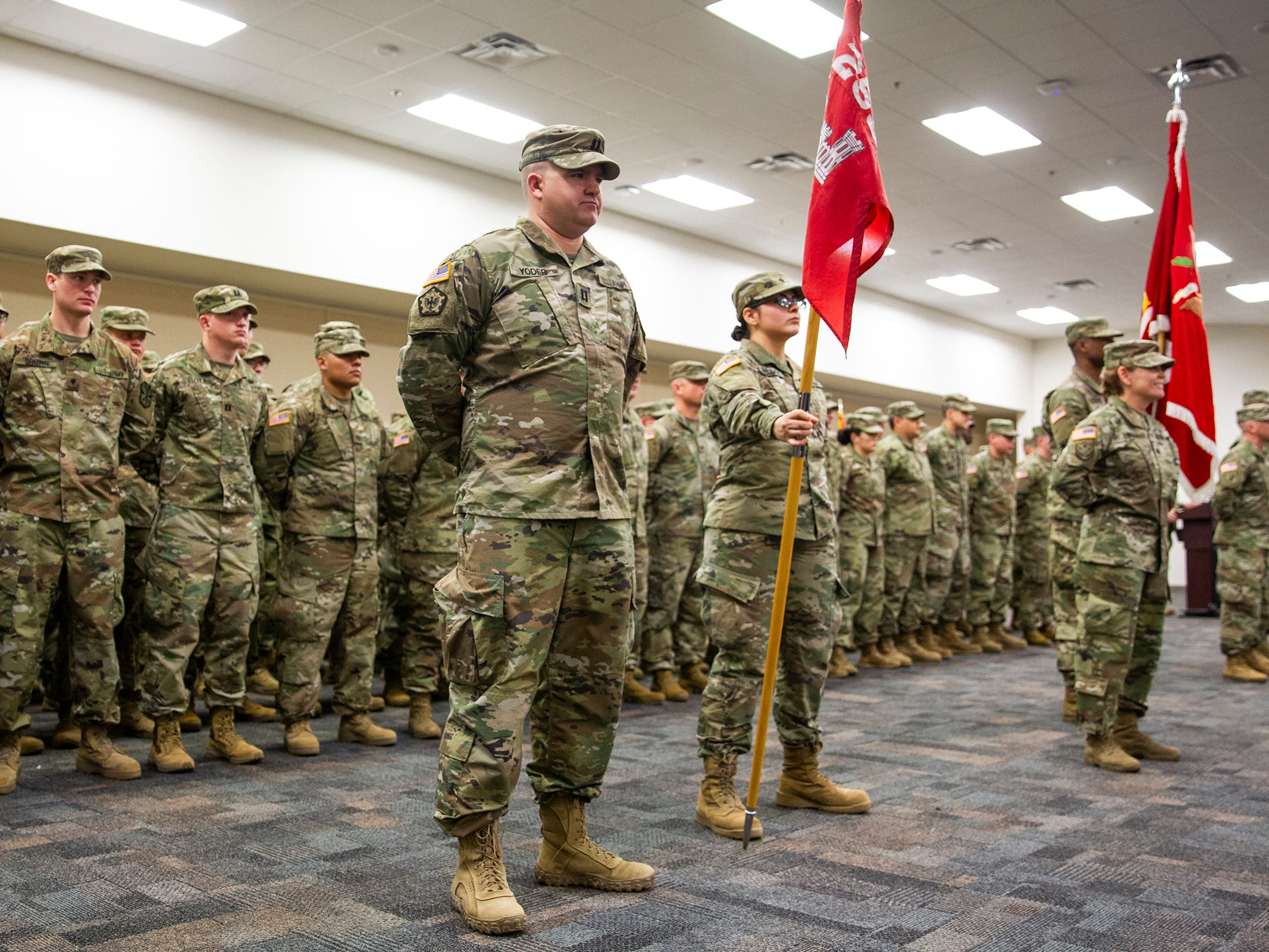 Soldiers of the 253rd Engineer Battalion stand in rows during their deployment ceremony at Papago Park Military Reservation on Sunday, Feb. 24, 2019. The soldiers boarded buses immediately after the ceremony.