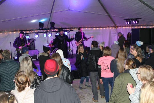 Master TC and the Visitors entertained the crowd in the party tent at the Burning Snowman Fest 2019 in Port Clinton.