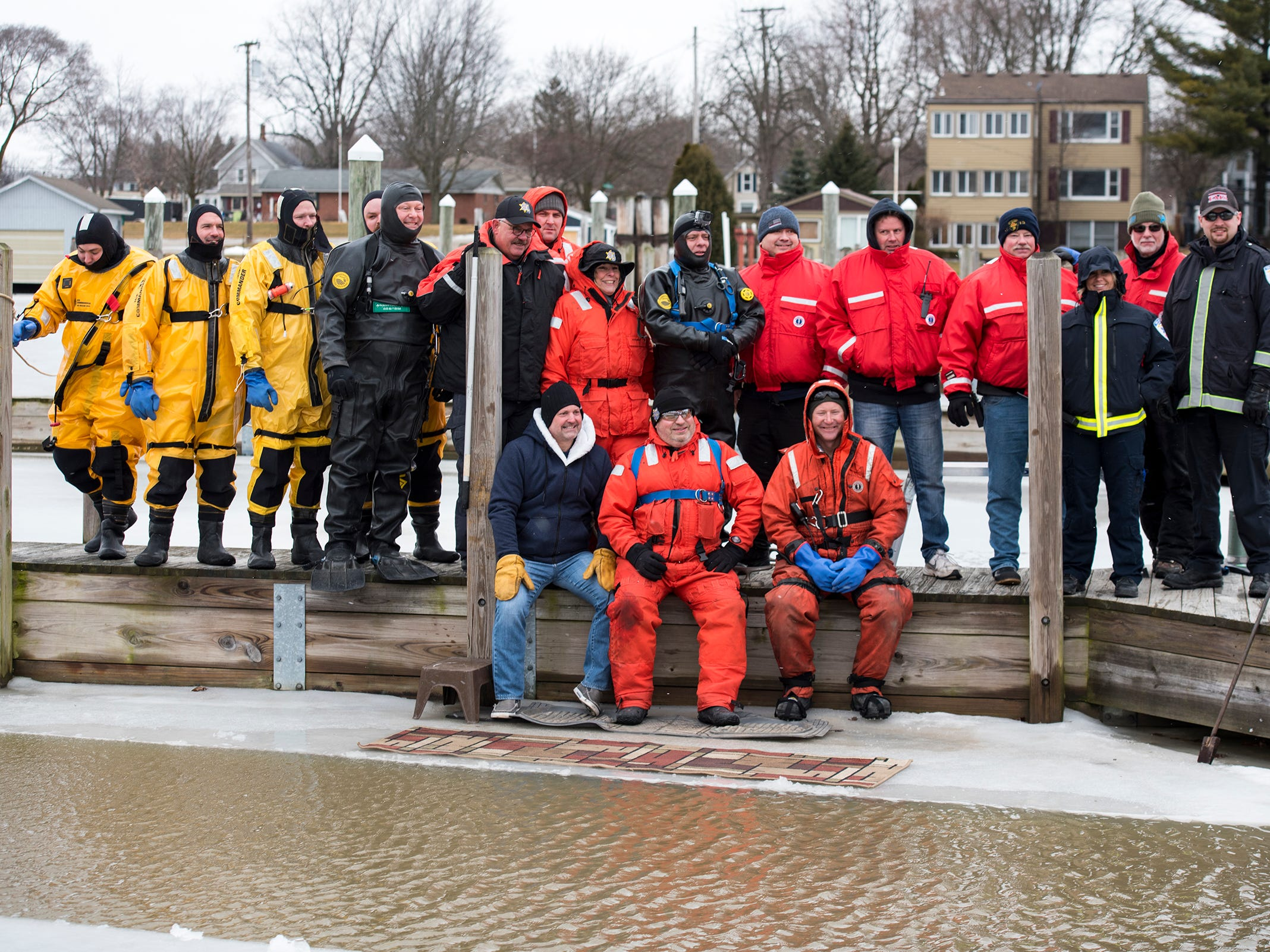 First responders on the scene of the annual St. Clair Polar Plunge gather for a group photo before the event Sunday, Feb. 24, 2019.