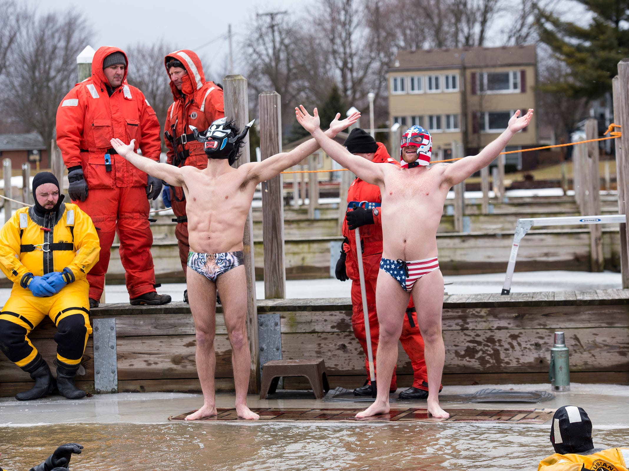 Sergio Hernandez, left, and Ryan Teeple strike a pose before they jump through the ice into the water in the St. Clair Boat Harbor Sunday, Feb. 24, 2019 during the annual St. Clair Polar Plunge. This was Hernandez's fourth plunge and Teeple's first.