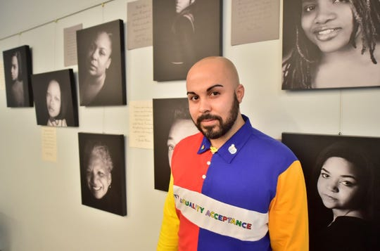 "Chambersburg photographer Phillip Whitley stands in front of eight of the 30 portraits included in his exhibit, ""Black Girl Magic,"" on display through March 31 at Coyle Free Library, Chambersburg.  Pictured on Friday, Feb. 22, 2019."