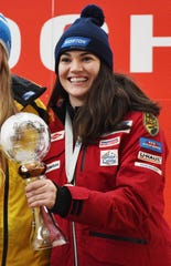 Glen Rock's Summer Britcher is shown with her trophy after finishing third in the final World Cup women's luge standings for the 2018-19 season.