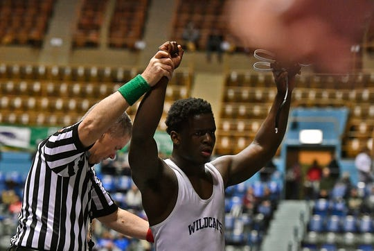 Dallastown's Jamal Brandon won the 220 pound match with a pin on Marques Holton of Central Dauphin during the PIAA District 3 Class 3-A championship, Saturday, February 23, 2019.John A. Pavoncello photo