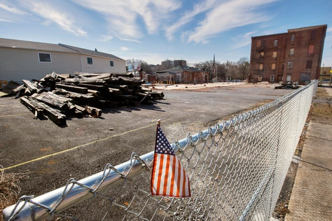 Fire-damaged timbers remain in a fenced-in area to the rear of what's left of the old Weaver Organ & Piano building in York, one year after fire ripped through the building, March 21, 2018, during a snow storm. The following day, firefighters Ivan Flanscha and Zachary Anthony died from injuries sustained when the structure collapsed.