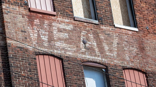 "Part of the facade of what is left of the old Weaver Organ & Piano building facing North Broad Street still says ""Weaver"" in 2019. Fire ripped through the building March 21, 2018 during a snow storm. Firefighters Ivan Flanscha and Zachary Anthony died from injuries sustained during a structure collapse the day after."