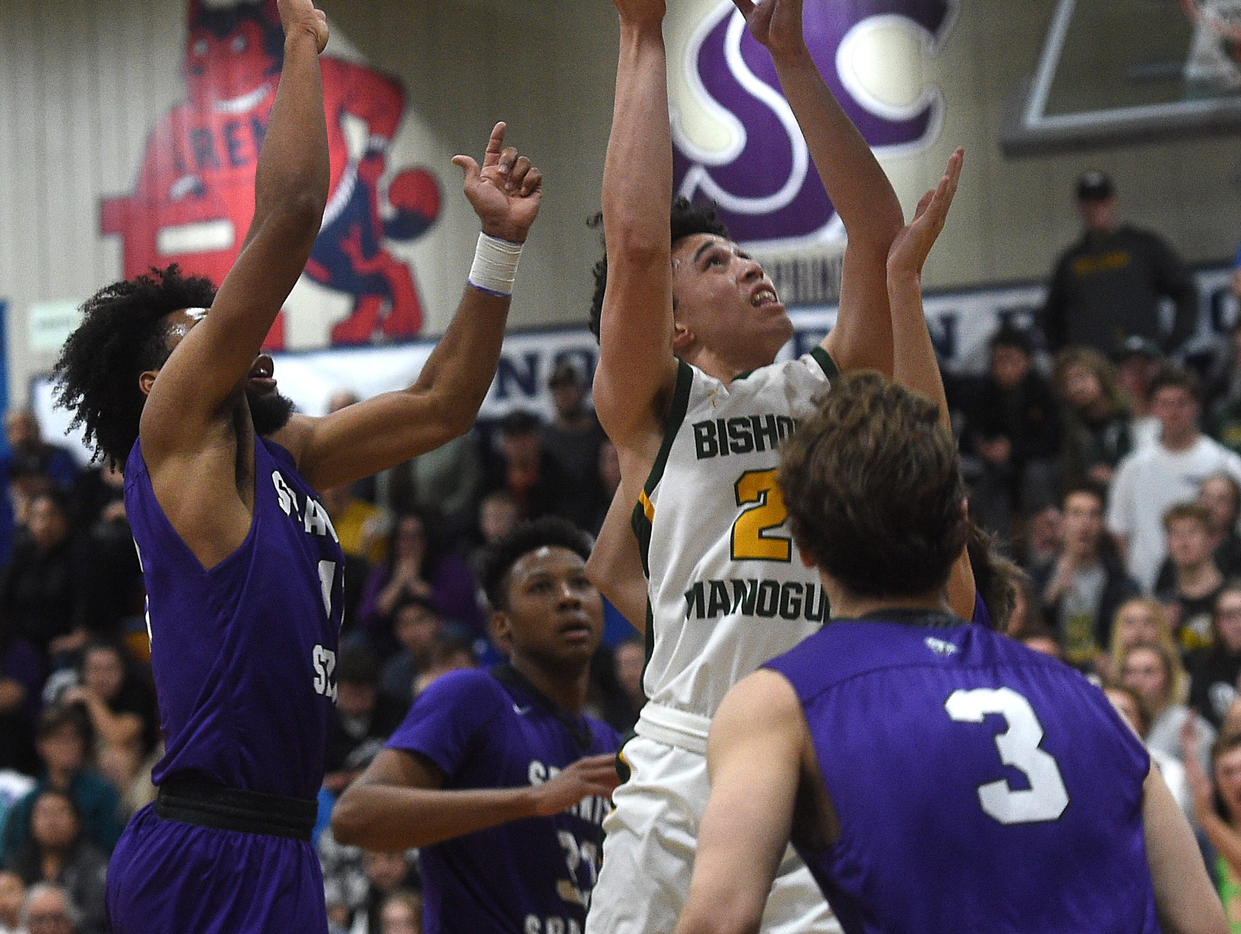 Bishop Manogue's Gabe Bansuelo shoots while taking on Spanish Springs during the Northern Region Basketball Championship game in Carson City on Feb. 23, 2019.