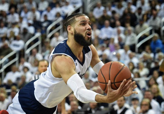 Nevada's Cody Martin shoots while falling Saturday night against Fresno State.