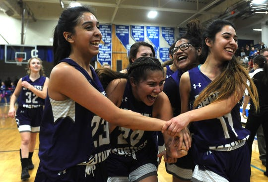 Spanish Springs celebrates after defeating Reno to win the Northern Region Basketball Championship game in Carson City on Feb. 23, 2019.