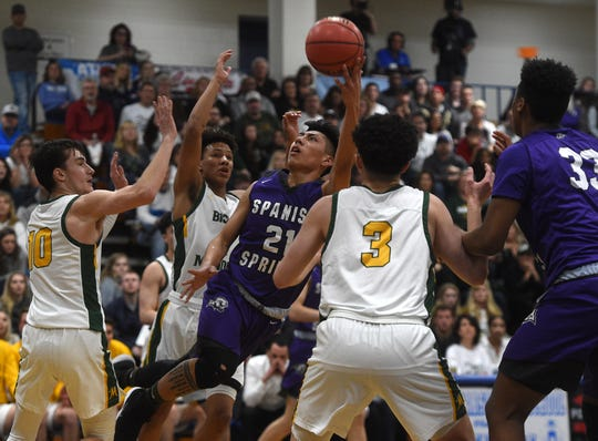 Spanish Springs' Leo Grass shoots while taking on Bishop Manogue during the Northern Region Basketball Championship game in Carson City on Feb. 23, 2019.