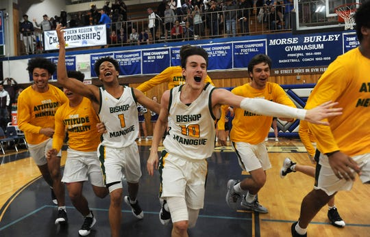 Bishop Manogue's Kolton Frugoli (10) leads the celebration after hitting the game winning shot to defeat Spanish Springs during the Northern Region Basketball Championship game in Carson City on Feb. 23, 2019.