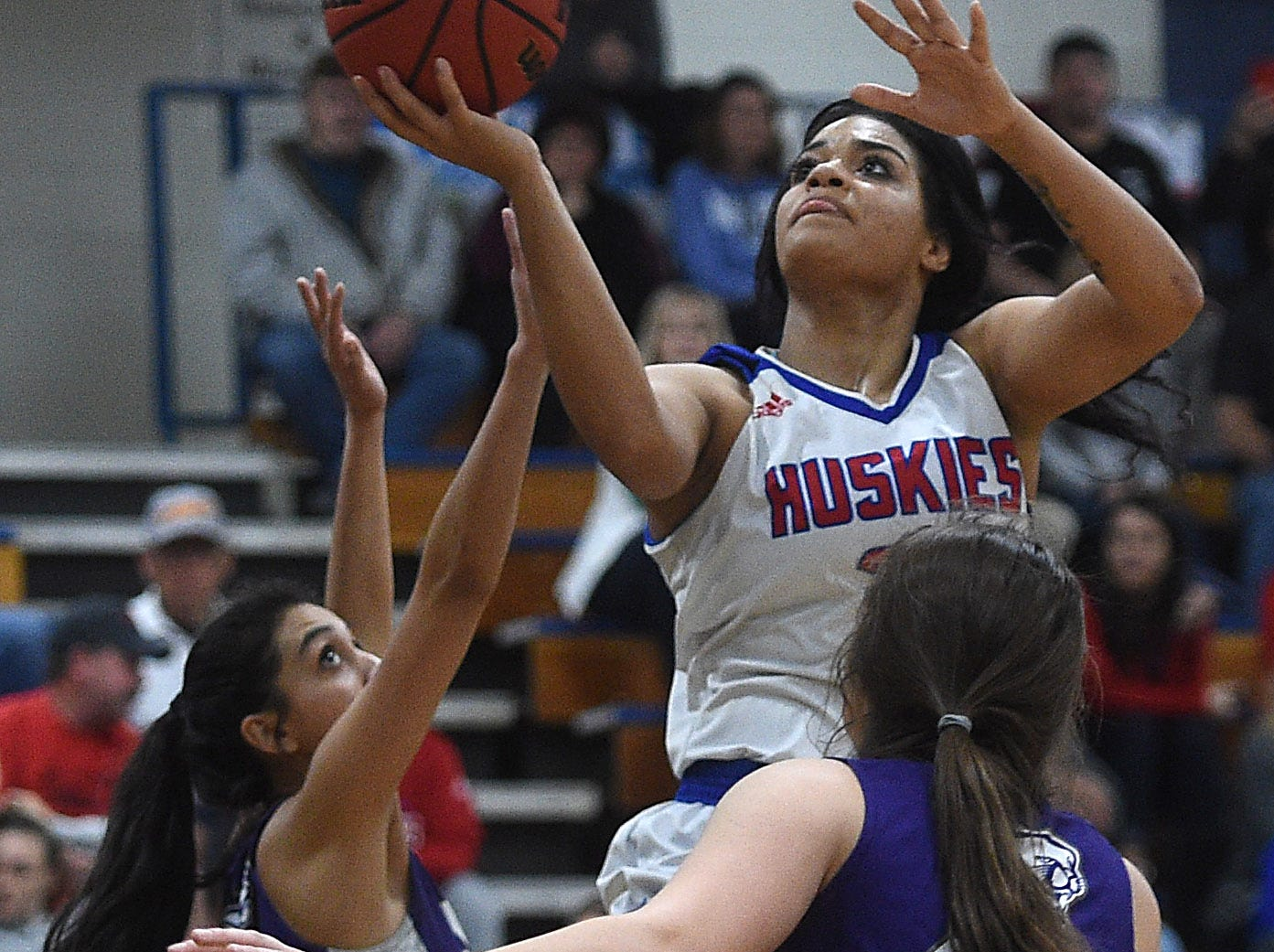 Reno's Kaitlynn Biassou shoots while taking on Spanish Springs during the Northern Region Basketball Championship game in Carson City on Feb. 23, 2019.