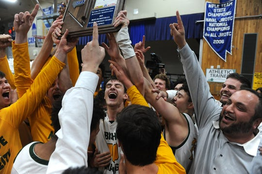 Bishop Manogue celebrates after defeating Spanish Springs during the Northern Region Basketball Championship game in Carson City on Feb. 23, 2019.