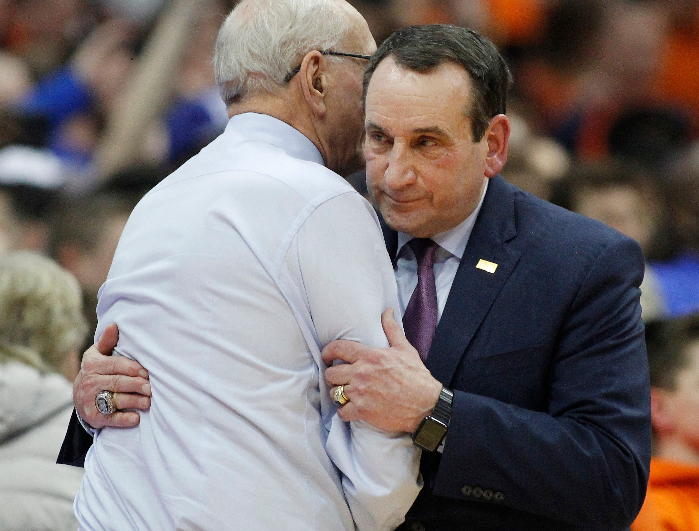 Duke coach Mike Krzyzewski, right, embraces Syracuse coach Jim Boeheim at the end of an NCAA college basketball game in Syracuse, N.Y., Saturday, Feb. 23, 2019. Duke won 75-65. (AP Photo/Nick Lisi)