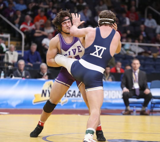 Hilton's Sam Deprez wrestles Liam McIntrye from West Hampton Beach in the 195-pound final match of the NYSPHSAA championships at the The Times Union Center in Albany on Saturday, February 23, 2019.