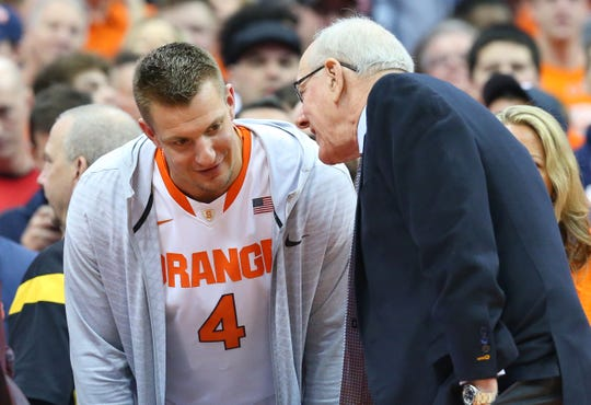 SYRACUSE, NY - FEBRUARY 23:  Rob Gronkowski of the New England Patriots talks with head coach Jim Boeheim of the Syracuse Orange prior to the game against the Duke Blue Devils at the Carrier Dome on February 23, 2019 in Syracuse, New York. (Photo by Rich Barnes/Getty Images)