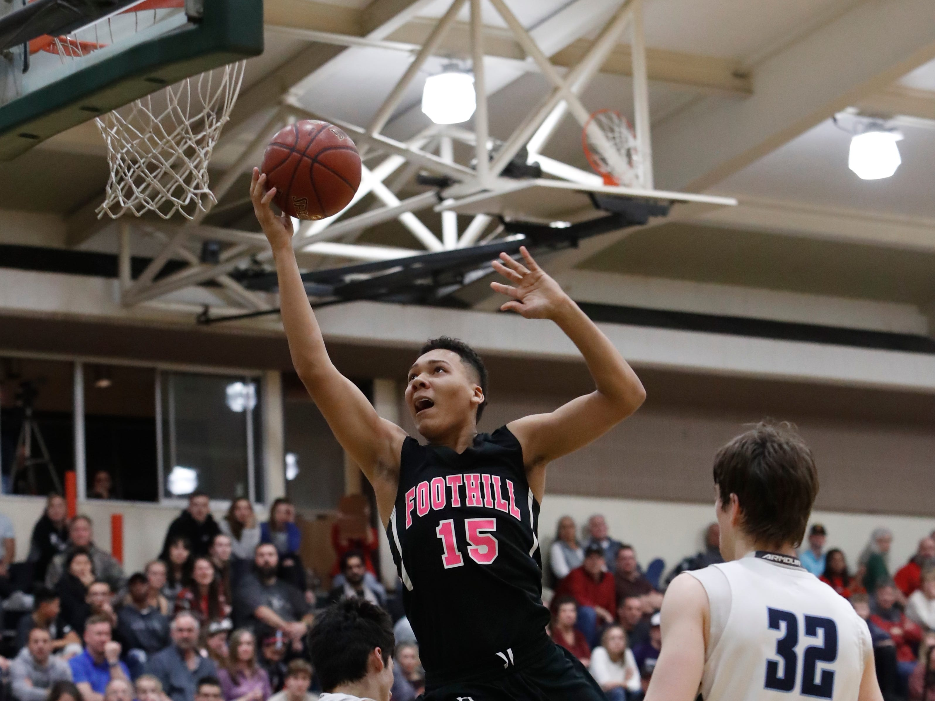 Foothill's Josiah Hutt attempts a layup during Pleasant Valley's 43-41 win over the Cougars in the Division III Northern Section championship at Shasta College on Saturday, Feb. 23.