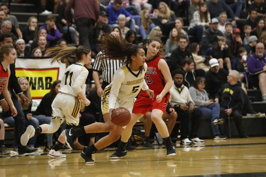 Enterprise senior Jadyn Matthews dribbles past Foothill's Jenna Wallace during the Hornets' 71-50 win in the Division III Northern Section championship game at Shasta College on Saturday, Feb. 23.