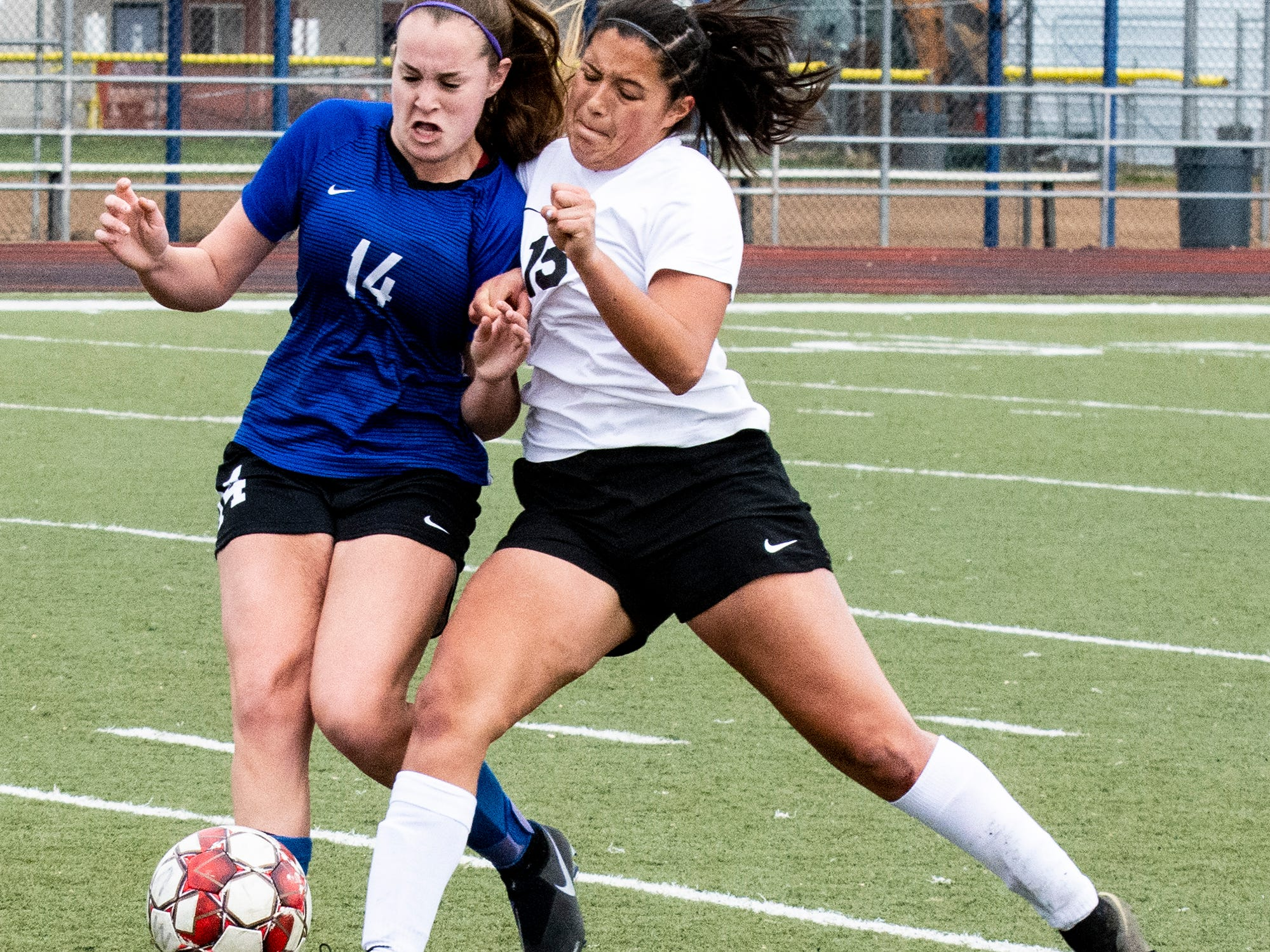 U-Prep's Alexis Hayward, left, and Corning's Nayeli Lara collide Saturday in their Division II Northern Section championship. U-Prep went on to win the title 4-1 on the Panthers' home field. U-Prep now advances to the state playoffs starting Tuesday against an opponent to be named later. Scoring for U-Prep were Isabel Lendman, Ryanne Ampi, Hayward and Savannah Leak. Meanwhile, Corning beat the U-Prep boys 3-0 in their D-2 soccer title game.