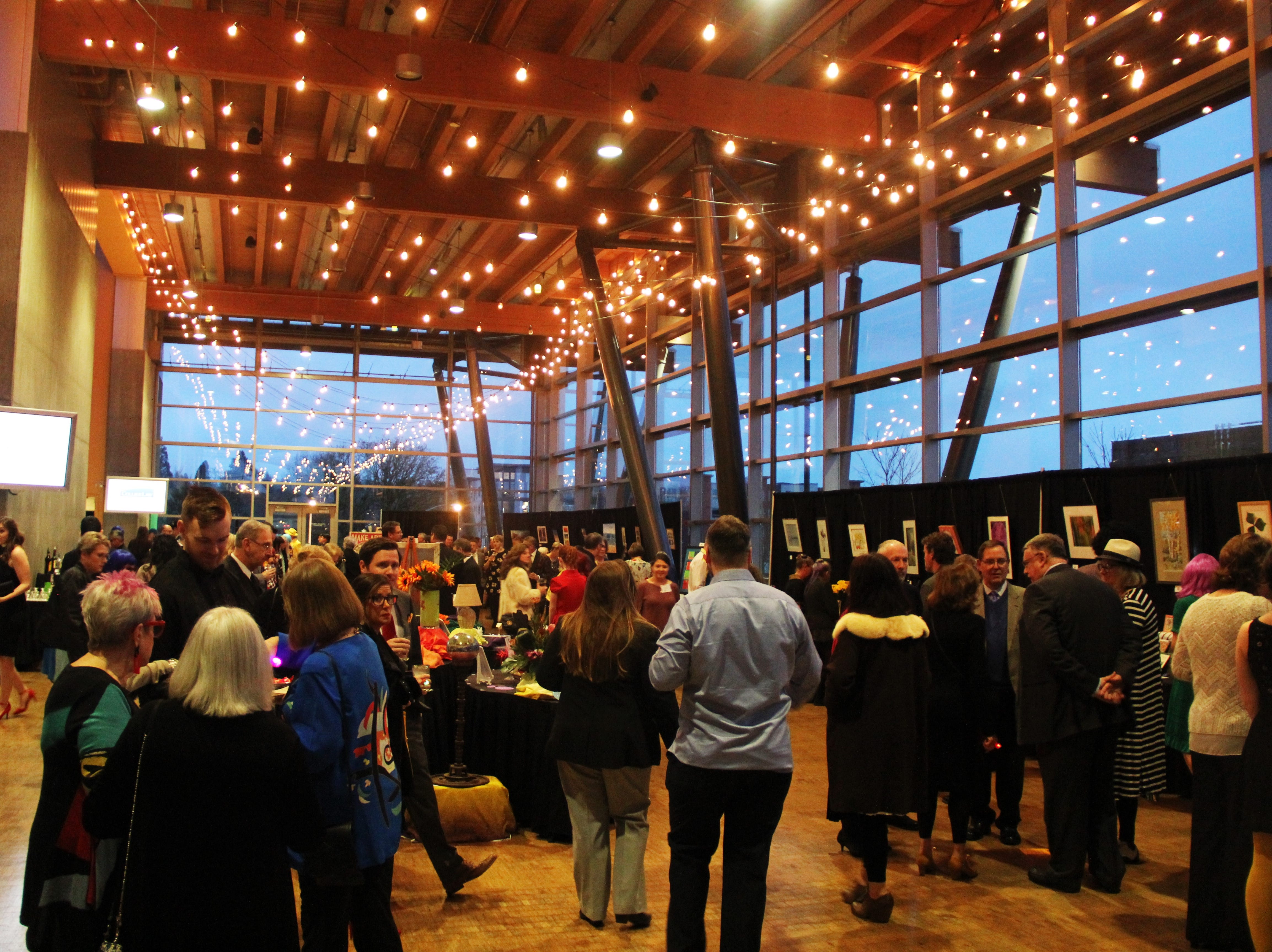 """People gather at the Salem Convention Center for the 20th Annual Clay Ball, a fundraiser for the Salem Art Association. The theme was """"Pop! Of Color."""""""