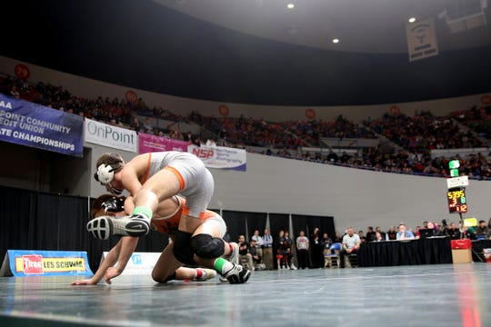 Silverton's Kaden Kuenzi, top, and Dallas' Haydn Millard compete in the 120 pound weight class in the OSAA Class 5A wrestling final at the Memorial Coliseum in Portland on Saturday, Feb. 23, 2019. Kuenzi won the championship.