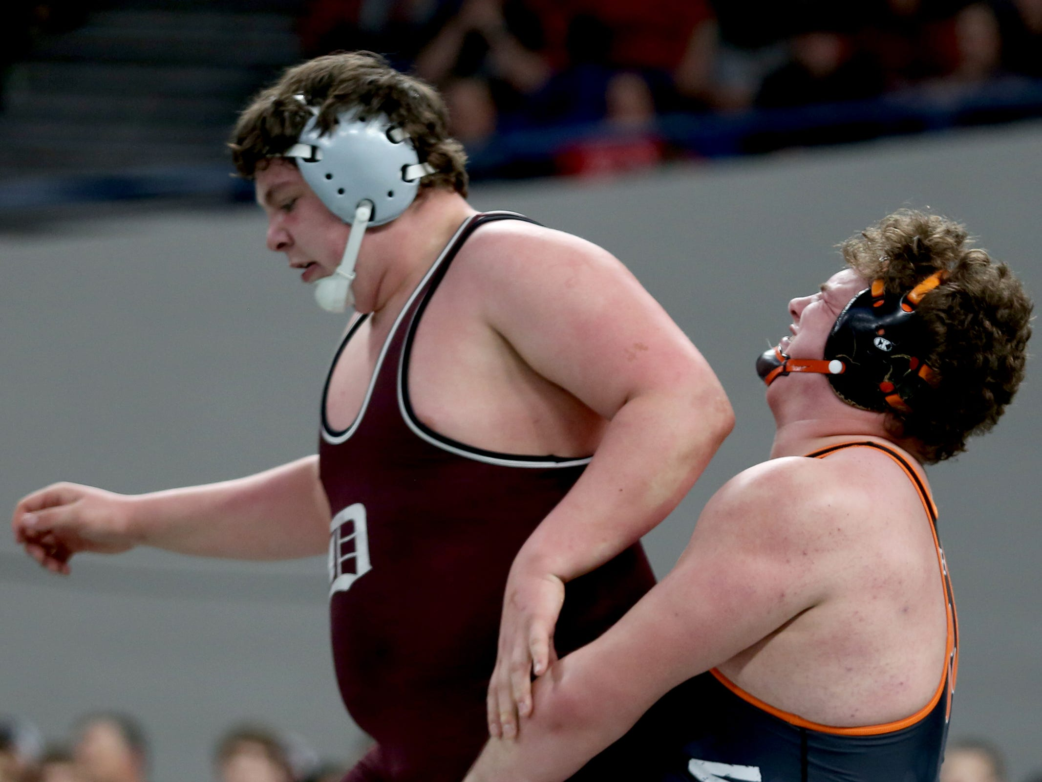 Dayton's Blake Larsen, left, and Willamina-Falls City's Jordan Mode compete in the 285 pound weight class in the OSAA Class 3A wrestling final at the Memorial Coliseum in Portland on Saturday, Feb. 23, 2019. Larsen won the championship.