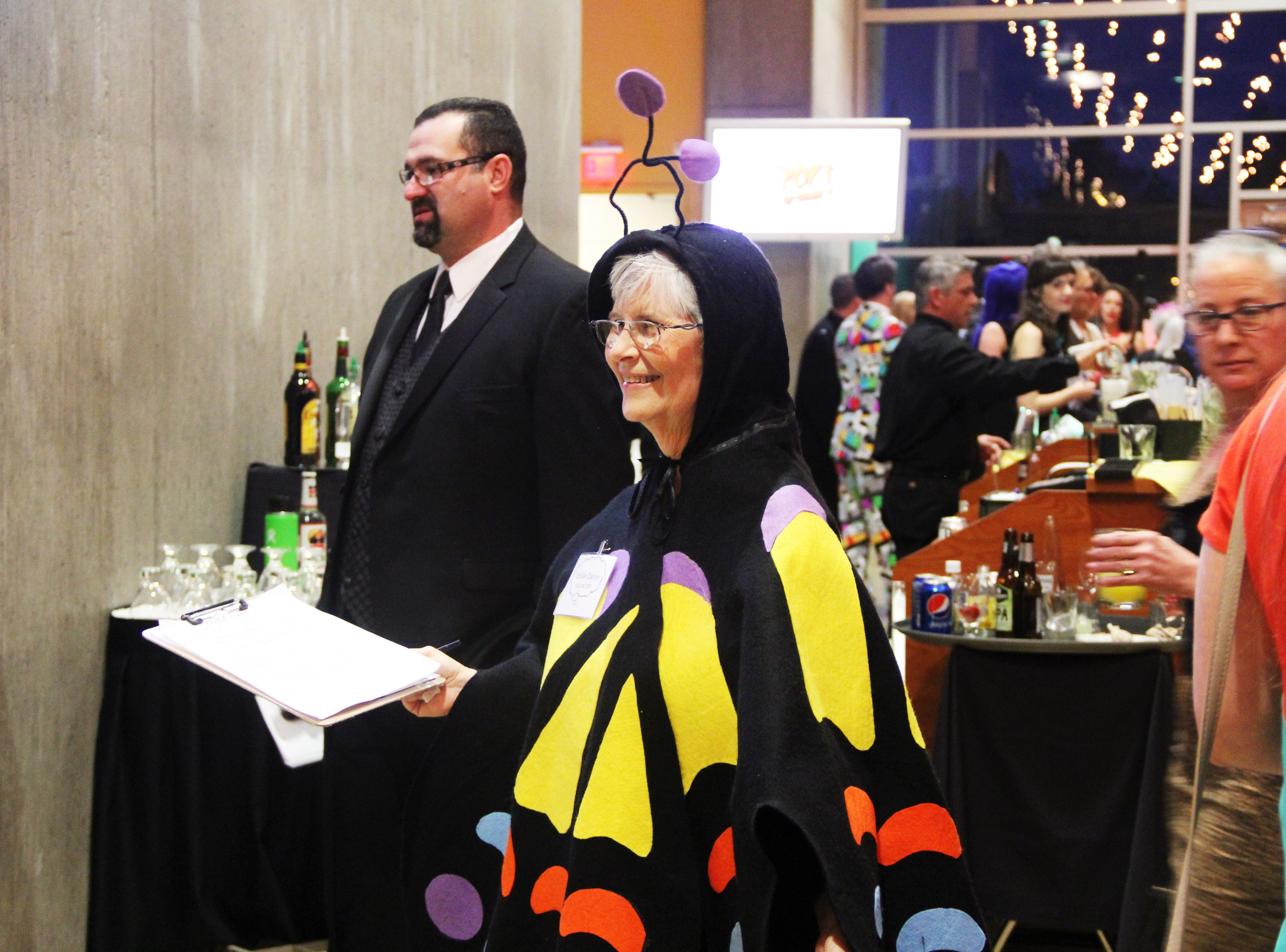Leslie Darland, of Dallas, wearing a butterfly outfit at the 20th Annual Clay Ball on Saturday, Feb. 23.