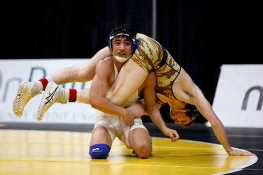 Woodburn's Giovanni Bravo, facing and Cascade's Kane Nixon compete in the 138 pound weight class in the OSAA Class 4A wrestling final at the Memorial Coliseum in Portland on Saturday, Feb. 23, 2019. Bravo won the championship.