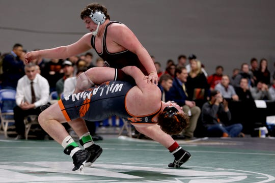 Dayton's Blake Larsen, top, and Willamina-Falls City's Jordan Mode compete in the 285 pound weight class in the OSAA Class 3A wrestling final at the Memorial Coliseum in Portland on Saturday, Feb. 23, 2019. Larsen won the championship.