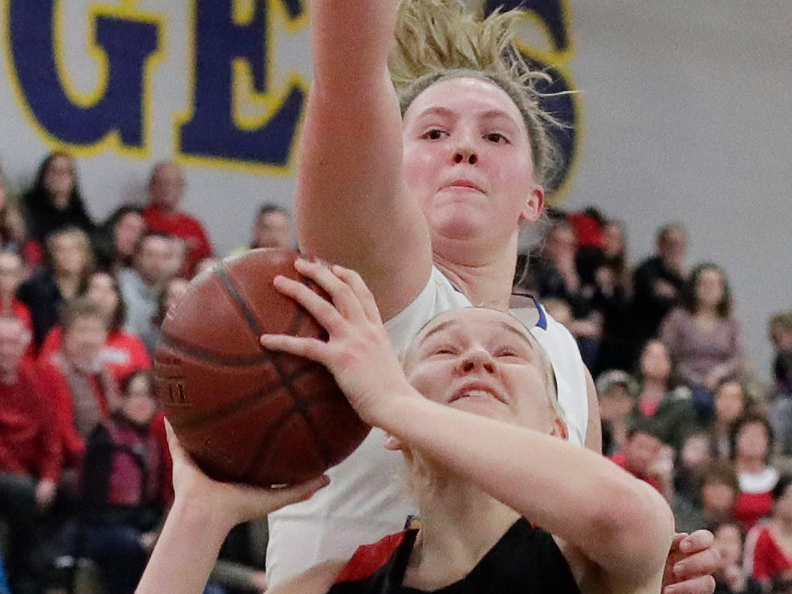 Oostburg's Ella TenPas (30) aims a shot while Howards Grove's Maddy Near (32) works to block her shot, Saturday, February 23, 2019, at Howards Grove, Wis.