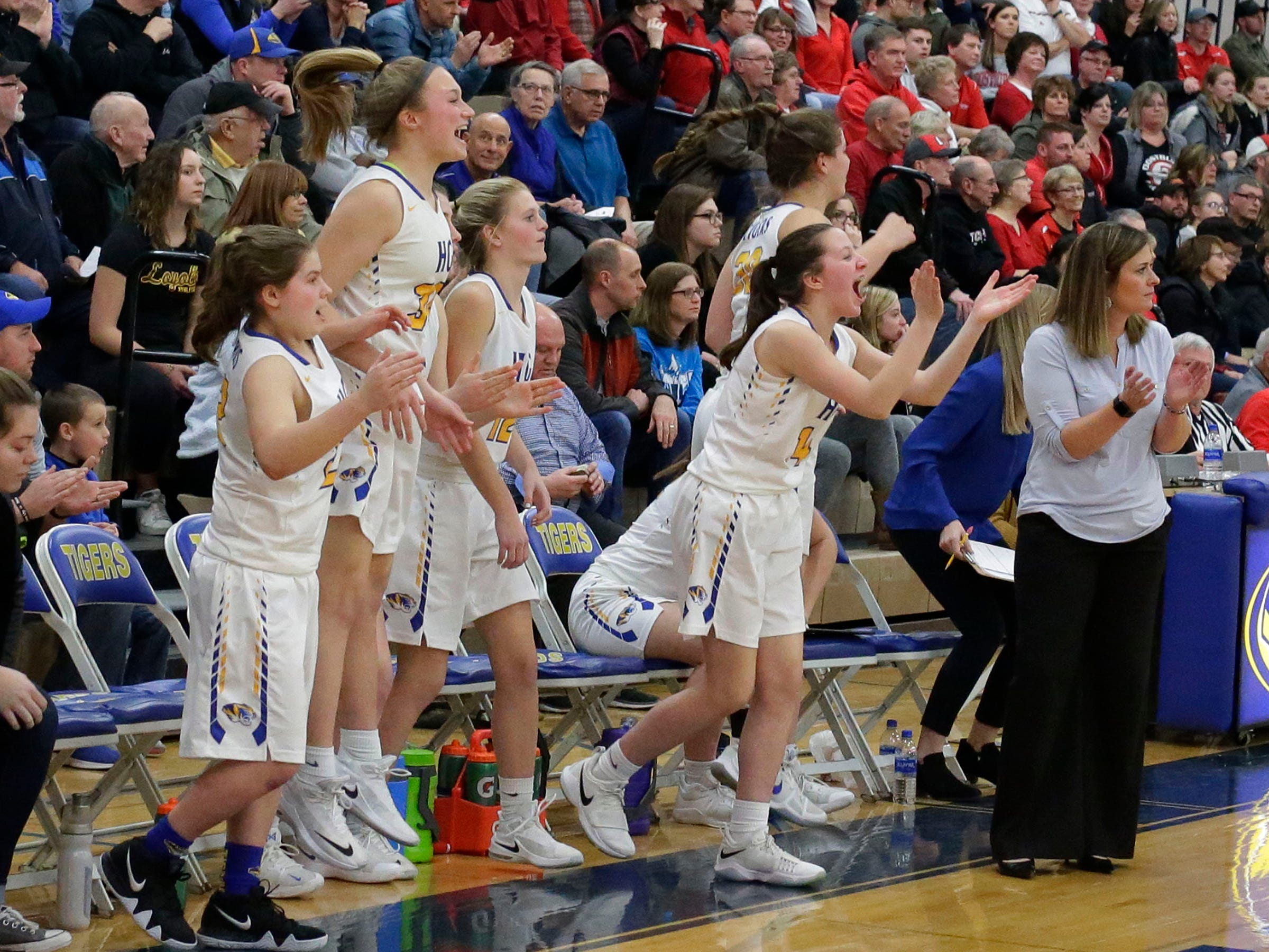 Howards Grove's bench explodes with joy in their overtime win over Oostburg, Saturday, February 23, 2019, at Howards Grove, Wis.