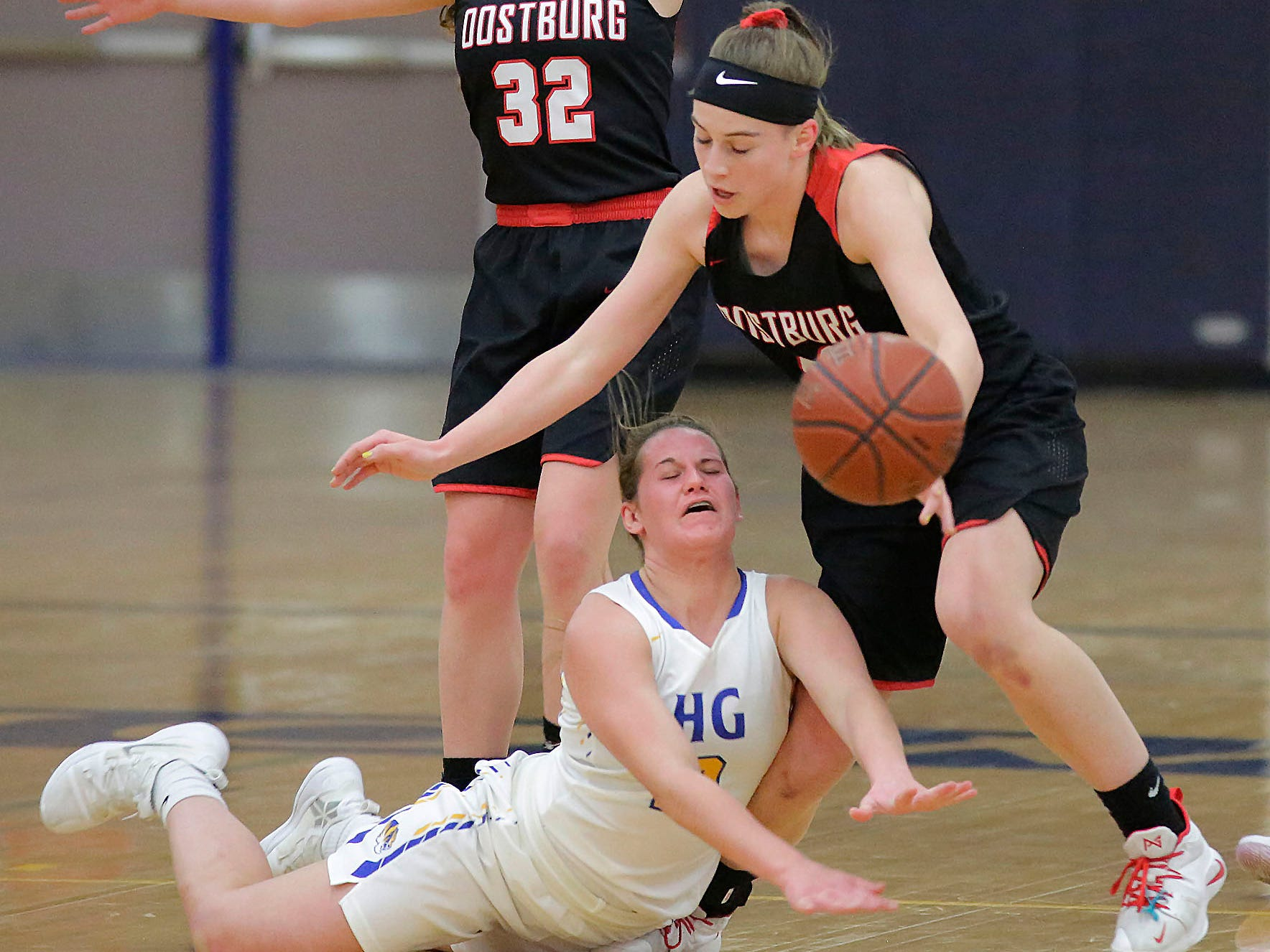 Howards Grove's Zayla Mueller (2) falls as she lunges towards the ball against Oostburg, Saturday, February 23, 2019, at Howards Grove, Wis.