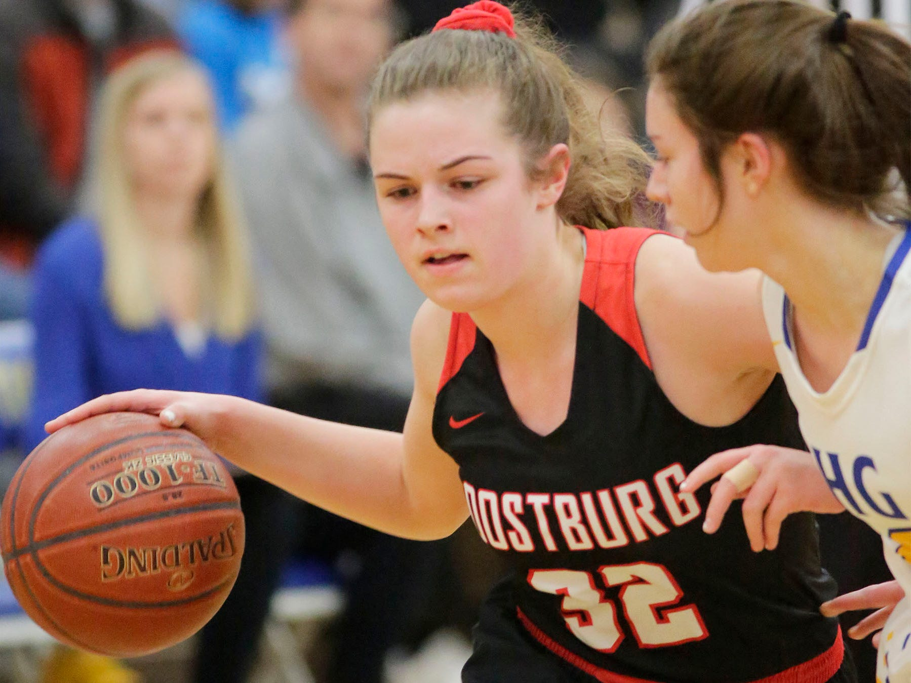 Oostburg's Cambell Van Ess (32) dribbles the ball around Howards Grove, Saturday, February 23, 2019, at Howards Grove, Wis.