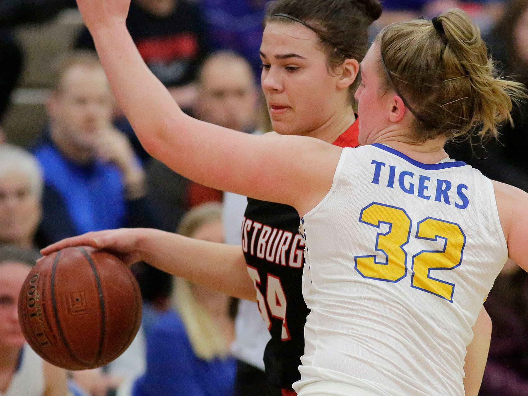 Oostburg's Skylar Ternes (54) dribbles the ball around Howards Grove's Maddy Near (32), Saturday, February 23, 2019, at Howards Grove, Wis.