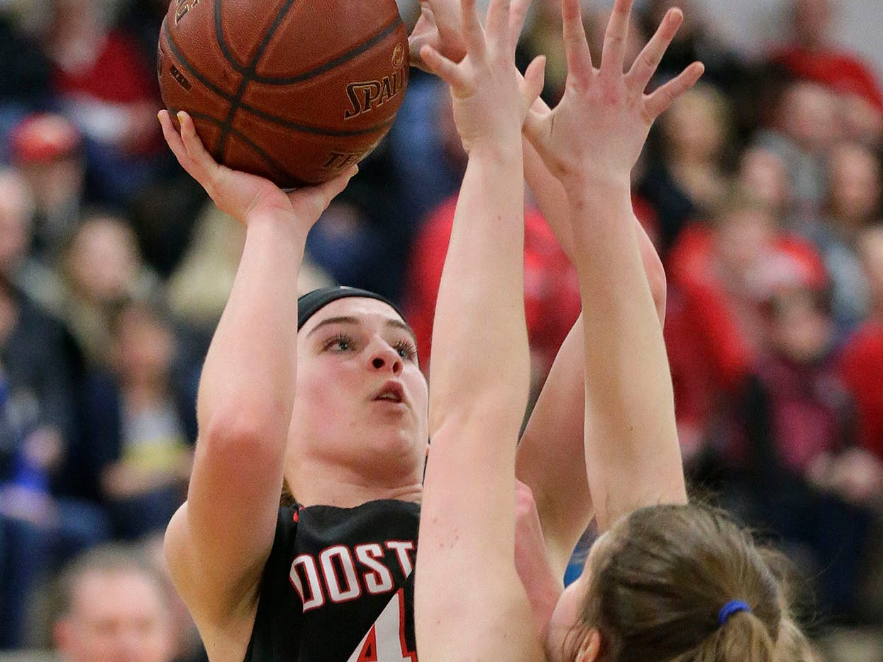 Oostburg's Kelsie Dulmes (42) aims a shot by Howards Grove's Rylee Reichwald (22), Saturday, February 23, 2019, at Howards Grove, Wis.