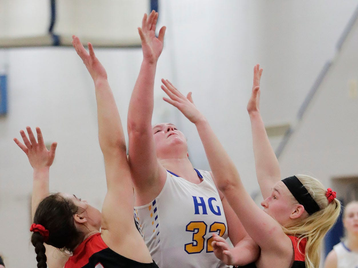 Howards Grove's Maddy Near (32) launches a shot against Oostburg's Skylar Ternes (54) and Ella TenPas (30), Saturday, February 23, 2019, at Howards Grove, Wis.