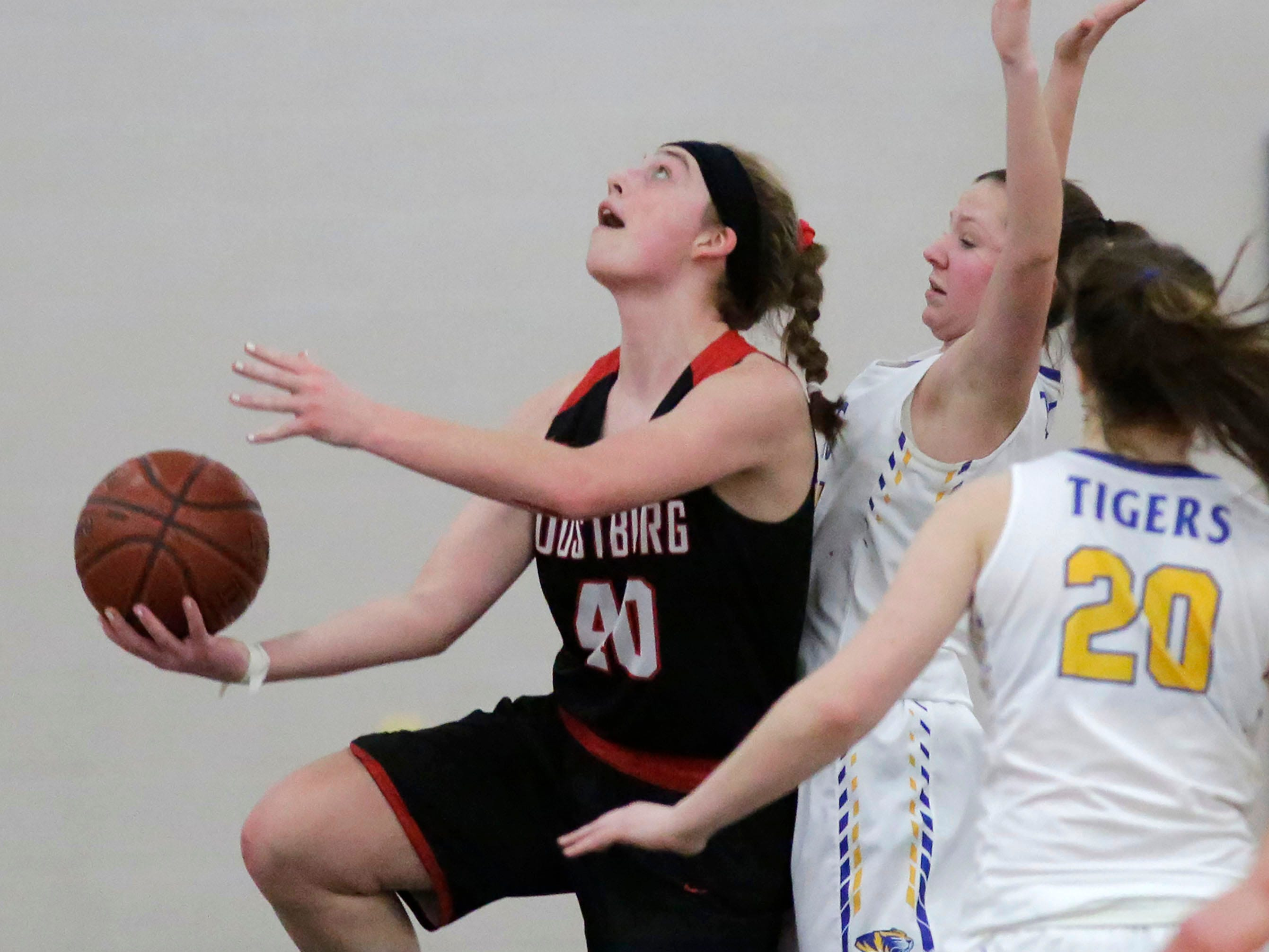 Oostburg's Ashley Ternes (40) launches an underhand shot against Howards Grove, Saturday, February 23, 2019, at Howards Grove, Wis.