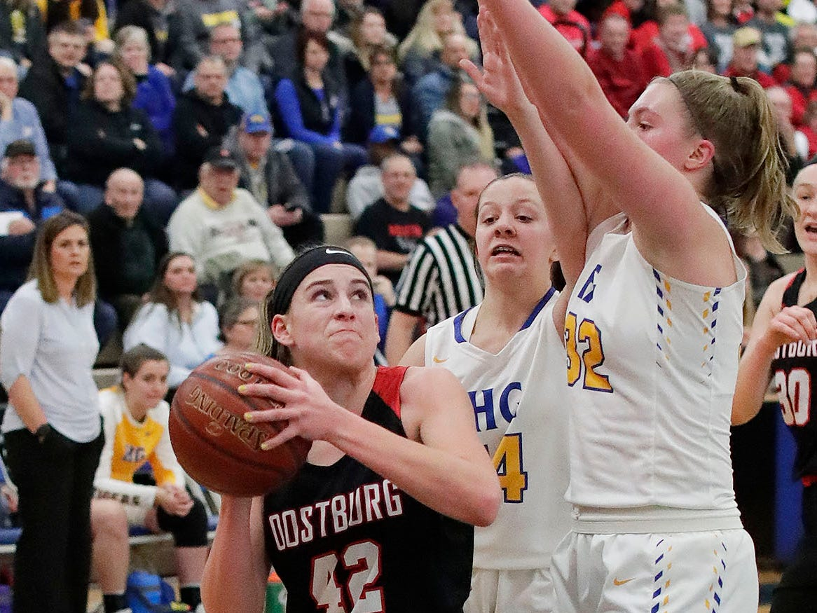Oostburg's Kelsie Dulmes (42) eyes the basket against Howards Grove, Saturday, February 23, 2019, at Howards Grove, Wis.