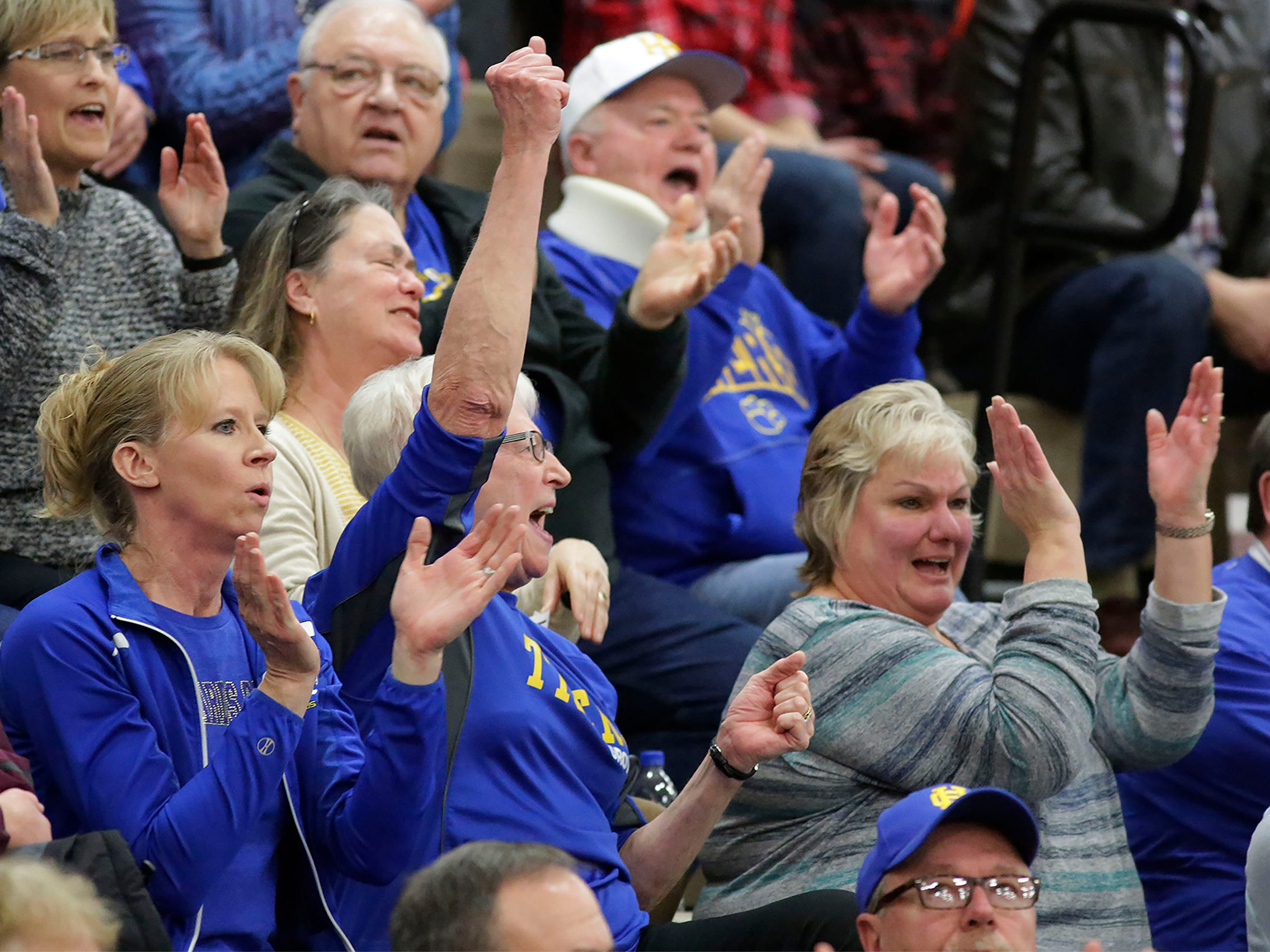 Howards Grove fans are jubilant during the second half against Oostburg, Saturday, February 23, 2019, at Howards Grove, Wis.