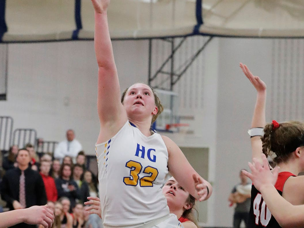 Howards Grove's Maddy Near (32) launches a shot against Oostburg, Saturday, February 23, 2019, at Howards Grove, Wis.