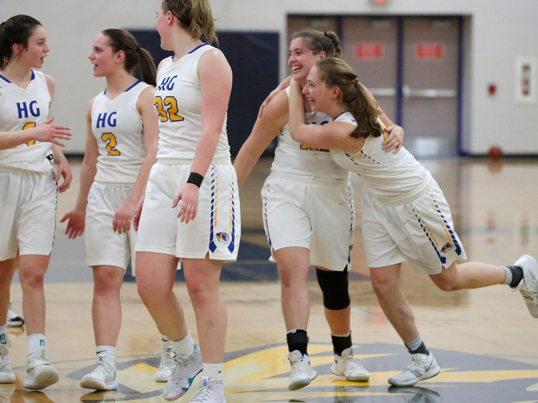 Howards Girls react to their victory over Oostburg to win the WIAA Division 4 regional final, Saturday, February 23, 2019, at Howards Grove, Wis.